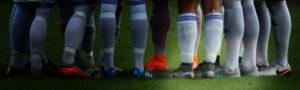 Schuhe im Team